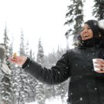 Seeing Whiskey Jacks on your Snowmobile Tour in Golden, BC