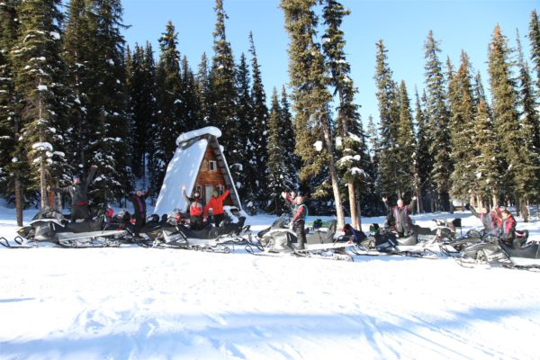 Snowmobile Tour in Golden BC: Lunch spot stop at the cabin