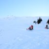Snowmobile Tour Participants playing in alpine bowl