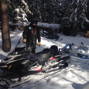 trail grooming with snowmobile